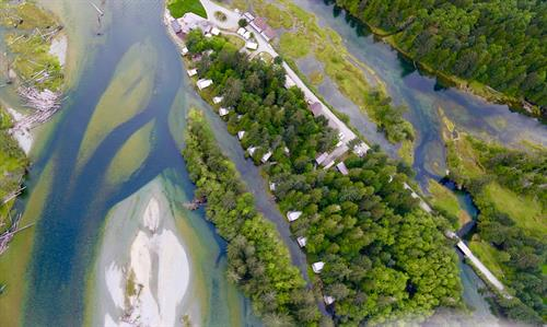 Gallery Image Clayoquot_Wilderness_Resort_Aerial_Riverfront_Tents_5x3.jpg