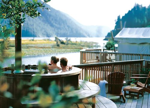 Gallery Image Clayoquot_Wilderness_Resort_Couple_in_Wood-Fired_Hot_Tub.jpg