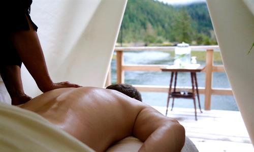 Gallery Image Clayoquot_Wilderness_Resort_Spa_Tent_Massage_Man.jpg