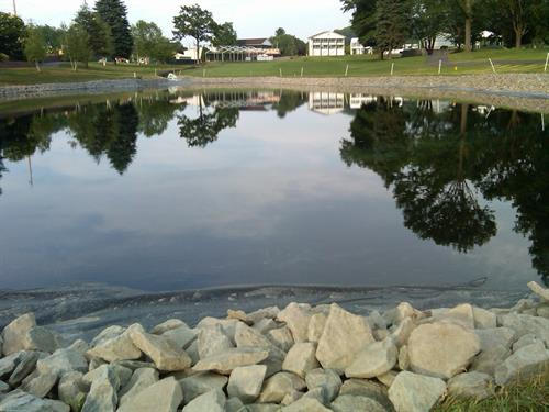 EnJoie Golf Course Endicott Pond filled and edging system installed