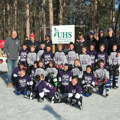 2018 Youth Weekend Pediatric Causes Awareness Game team picture with Senator Fred Akshar