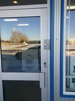 Installed blocker plate on a glass aluminum door