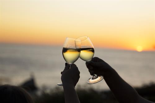 Gallery Image Wine-Glasses-Sunset-Albion-River-Inn-website(1).jpg