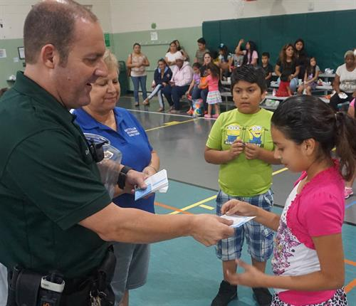 Community Policing Officer donated Rays tickets for a free raffle at our Backpack Event
