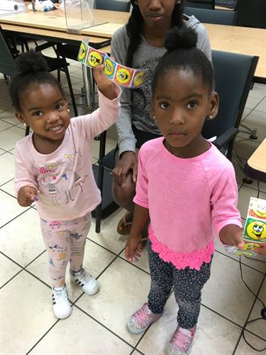 Girls get stickers from WIC Nurse