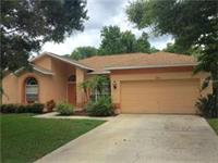 Smaller 1800 sq foot Palm Harbor home on a lake