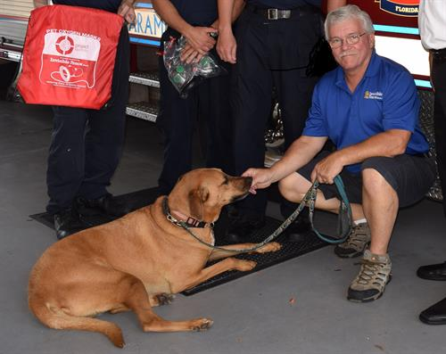 Chuck and Murphy donating Project Breathe Pet oxygen masks