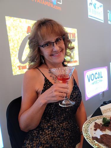 Realtor, Debbie enjoying the 007 Night open bar!