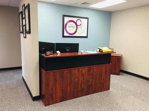 Reception desk at IPMG. Local Lafayette Business.