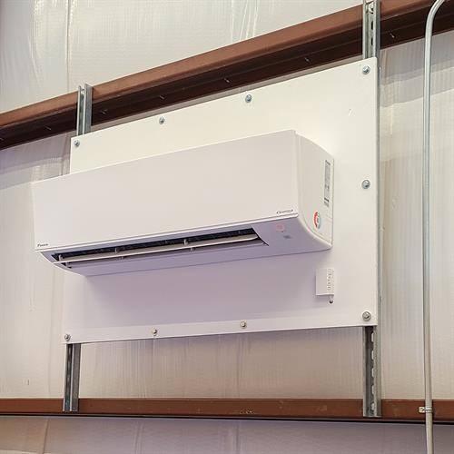 Ductless Indoor unit mounted in a work shop