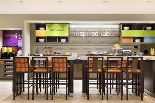 The Inspired Table offers complimentary hot breakfast each morning, with a rotating variety of options.