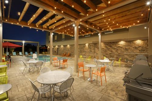 Relax on our outdoor patio while using the barbecue grill.