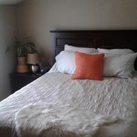 Comfortable Queen bed with a selection of pillows for a great night sleep