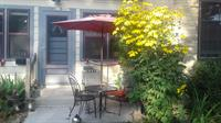 Front patio area for morning coffee or afternoon wine and watch the people walk by