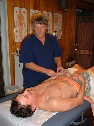 Mr. Nanos treating a patient