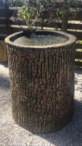 One of our one-of-a-kind birdbaths! A large oak tree trunk