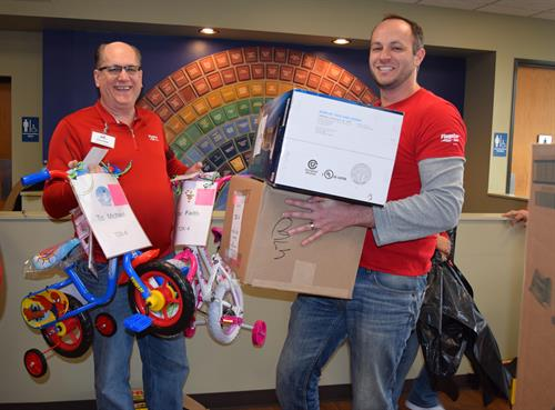 Flagstar Bank volunteers helping with Adopt- A-Family