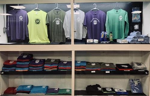 Pro-Shop items - Shirts, towels, pool/taning gear