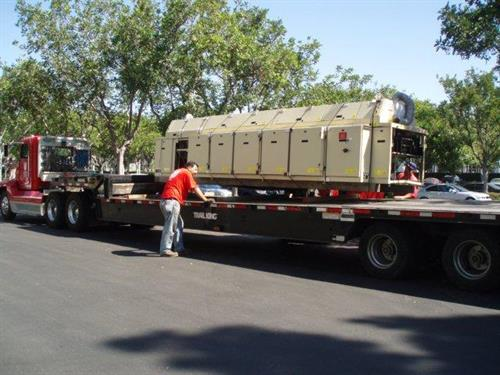 Rigger flatbed truck for oven relo