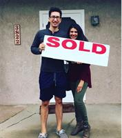 My clients receiving the keys to their first home in my neighborhood!