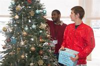 Pineland Learning Center students decorate a prize holiday tree at Inspira's Twice Loved Treasures Thrift Shop before distributing raffle tickets to the store's customers.