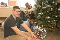 Students from Pineland Learning Center gather near a tree they donated and decorated at Inspira's Twiced Loved Treasures Thrift Shop.  The school's students are involved in volunteer projects throughout the year at the thrift shop and at Inspira's Fitness Connection in Vineland.  These volunteer projects are an extension of the school's transition program.