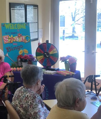 NJ CC having Fun playing bingo with the residents at Spring INto Bingo Spring Oaks Assisted Living Facility