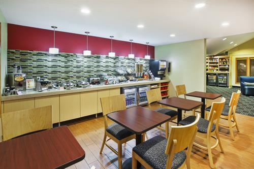 Hot Breakfast Buffet daily with waffles, eggs, sausage, oatmeal, variety of cereals, pastries, fruit and more