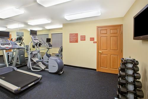 Exercise Facility with cardio equipment and free weights.