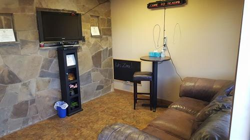 Waiting area with TV and kids chalkboard
