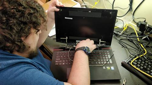 Dalton working on a laptop