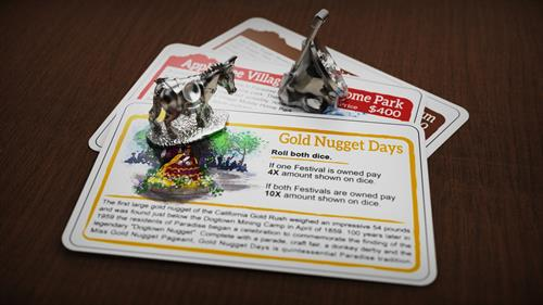 The property deed cards and game pieces