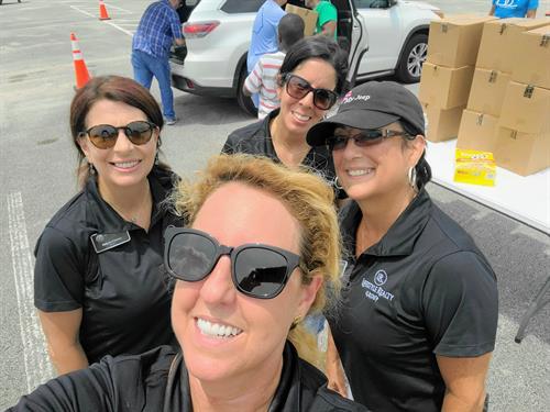 LRG team members volunteering at the Food Drop.