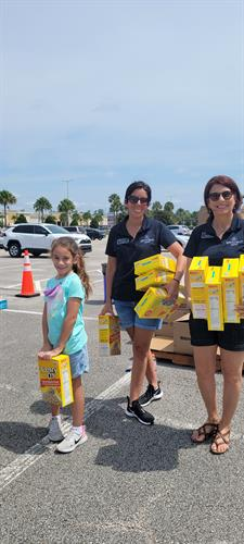 Teaching the next generation to volunteer - Petra and Felicia at the Food Drop at Daytona International Speedway.