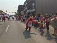 The State Farm bear loves to put smiles on the childrens' (and adults'!) faces at the Galesburg parades