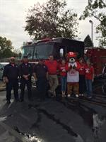 Galesburg firefighters, Shawn, and team members after Fire Prevention Day 2016