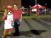 Shawn, agent, and the State Farm bear together at a R.O.W.V.A. highschool football game