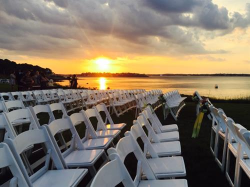 White Garden Chairs Set for an Oceanview Ceremony