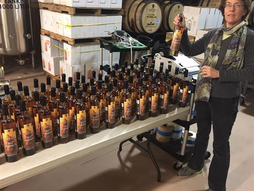 Kathy ready to box a batch of our Ryan & Wood Rye Whiskey.