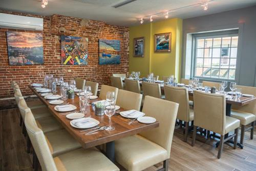 A view of our lovely Private Dining Room, used during regular hours for reservations but also available for private gatherings, staff events, rehearsal dinners and much more!