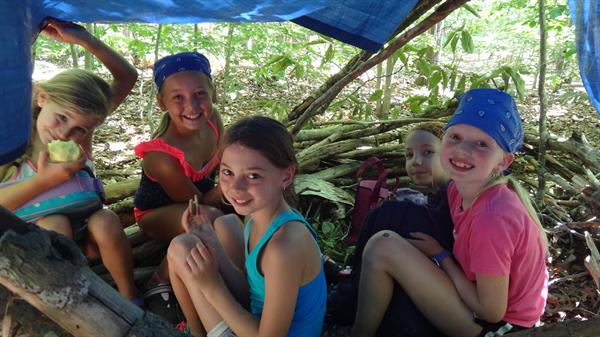 Every group makes their own shelter on the Survival Rockport Summer Adventure