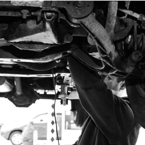 Mechanic, Gary Lane working under a vehicle