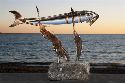 Catch of the day in bronze and glass