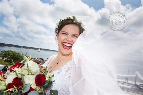 Happy bride overlooking Gloucester Harbor