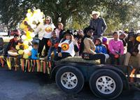 Past president Cynthia Bell Malveaux, recording Sec. Beverly Boyer, financial Sec. Robbin Burrell, Marcus Vaughn, Ariana (Gabby) Sneed and children ride on the African-American Historic Preservation Committee's candy float in the annual Martin Luther King Jr. Remembrance Day parade, hosted by the La Marque Alumni Association, Jan. 18, in Texas City.