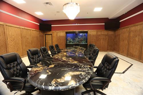 Host your meetings and events in our large chandeliered conference room with custom marble conference table