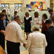 Ministry Leads Prayer Before First Mass