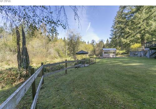 Spacious sunny yard with view of Salmon Creek