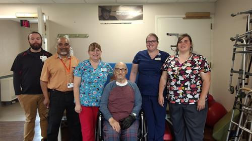 Staff wishing a resident farewell after his rehab stay at MediLodge of Gaylord