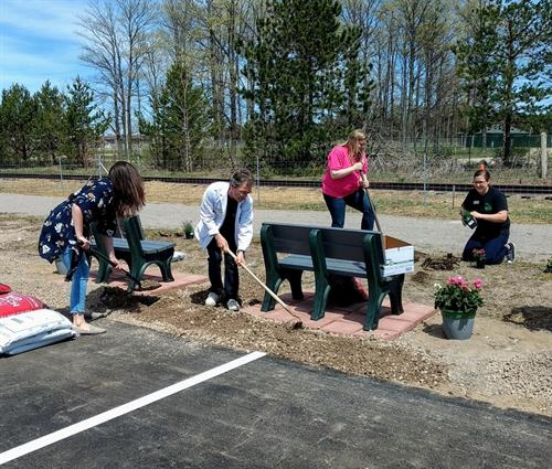 Staff working hard on our bench area for the Belle Iron Trail